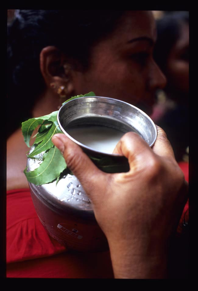 Pooja_milk_jug_on_shoulder